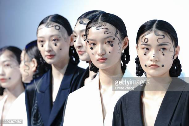 Models walks the runway during the PINHUI collection show by Chinese designer Zhao Pinhui on day four of China Fashion Week at 751D.PARK on October...
