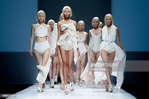 Models walks the runway wearing designs the by ESMOD Beijing Graduates Show during the 2014 China Graduate Fashion Week at the 751D-PARK Work shop on...