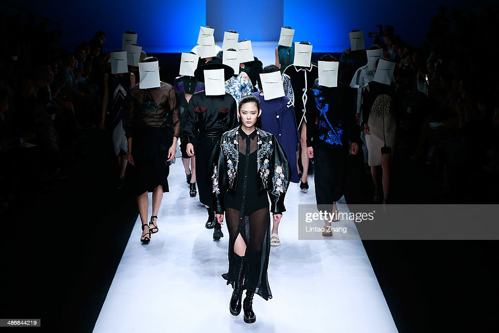Models walks the runway wearing designs the by Hubei Institute of Fine Arts Graduate Show during the 2014 China Graduate Fashion Week at the 751D-PARK Work shop on April 26, 2014 in Beijing, China.