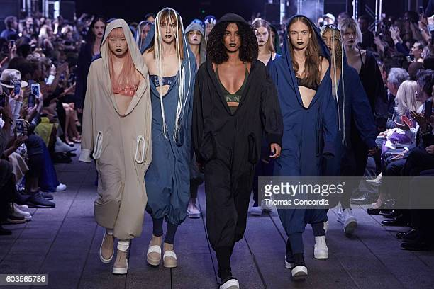 Models walks the runway wearing DKNY Spring 2017 on the highline during New York Fashion Week on September 12 2016 in New York City