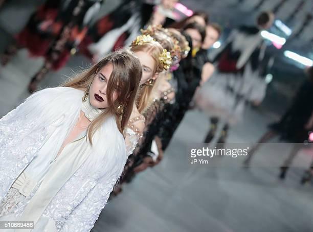 Models walks the runway wearing Rodarte Fall 2016 during New York Fashion Week on February 16 2016 in New York City