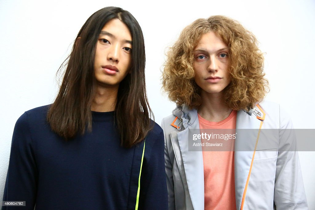 Models Wang Hao, age 20, from China and model Jack Donovan, age 25, from United States, pose at the Garciavelez Presentation during New York Fashion Week: Men's S/S 2016 at Industria Superstudio on July 13, 2015 in New York City.
