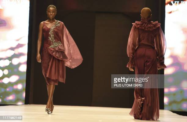 Models wear a Yutee Rone creation during the yearly Lagos Fashion Week in Lagos, on October 24, 2019. - Lagos Fashion Week is a fashion platform...