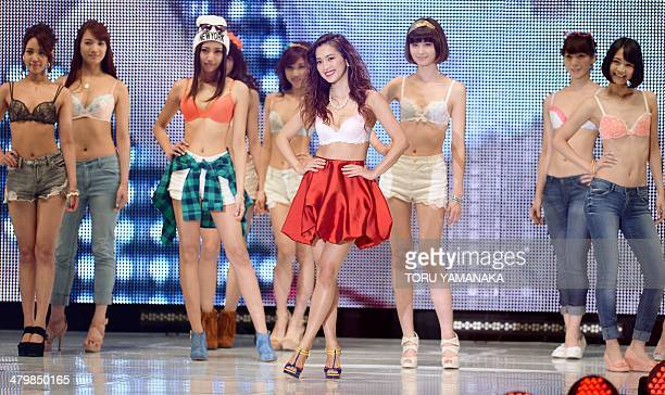 Models wear brassieres of Japanese lingerie maker Wacoal during the Tokyo Runway 2014 spring summer collections in Tokyo on March 21 2014 AFP...