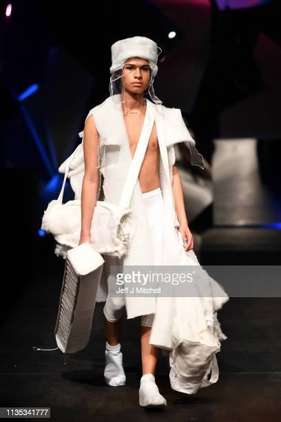 Models wear clothes by Melody Uyanga Ramsay during the Fashion Design and Textile Design catwalk show at the Vic in the Glasgow School of Art on...