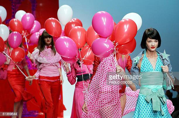 Models wear creations as part of Frankie Morello's Spring/Summer 2005 women's collection at Milan's fashion week 26 September 2004. AFP PHOTO/Paolo...