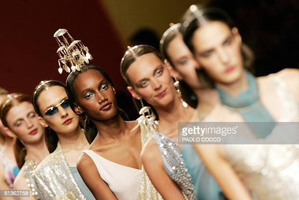 Models wear creations as part of Pollini by Rifat Ozbek's Spring/Summer 2005 women's collection at Milan's fashion week 27 September 2004. AFP...