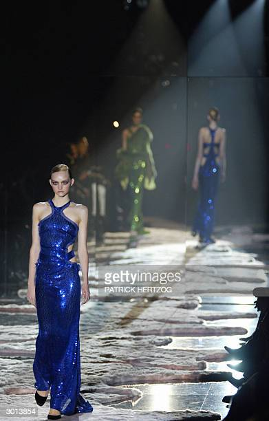 Models wear creations as part of US designer Tom Ford last presentation for Gucci's Autumn/Winter 2004-2005 women's collection at Milan's fashion...