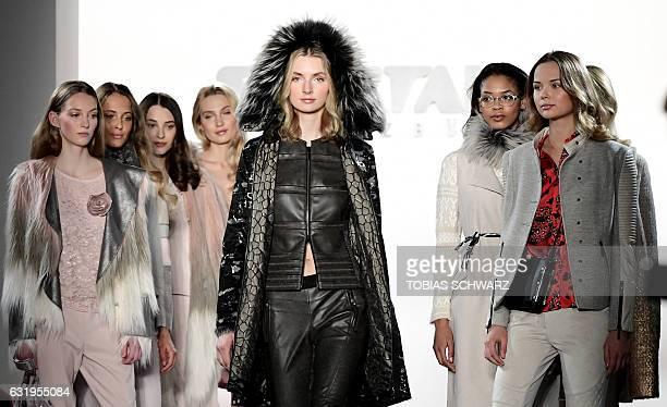 Models wear creations by Sportalm at the Berlin Fashion Week in Berlin on January 18 2017 / AFP / Tobias SCHWARZ