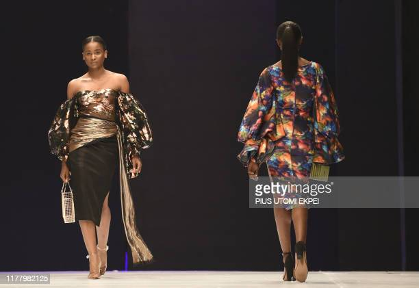 Models wear DZYN creations during the yearly Lagos Fashion Week in Lagos, on October 24, 2019. - Lagos Fashion Week is a fashion platform bringing...