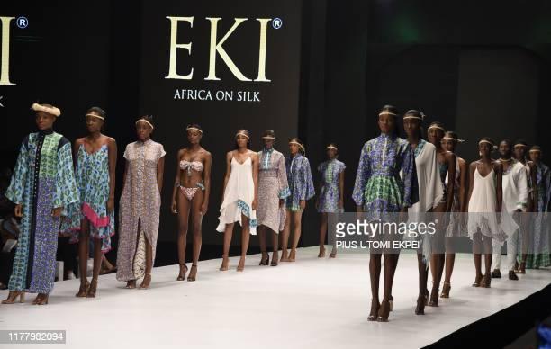 Models wear EKI silk creations during the yearly Lagos Fashion Week in Lagos, on October 24, 2019. - Lagos Fashion Week is a fashion platform...