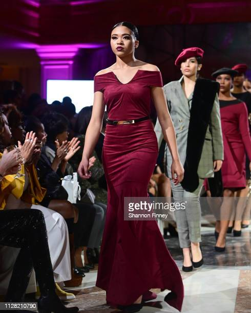Models wear ensembles from the Brittany Christina Collection at the District of Fashion Fall/Winter 2019 Runway Show on February 07 2019 at the...
