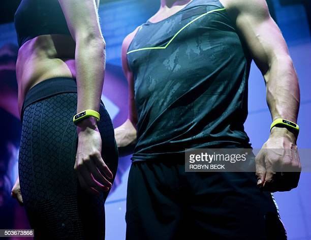Models wear iFit monitors during a performance at the iFit booth January 6 2016 on the first day of the CES 2016 Consumer Electronics Show in Las...