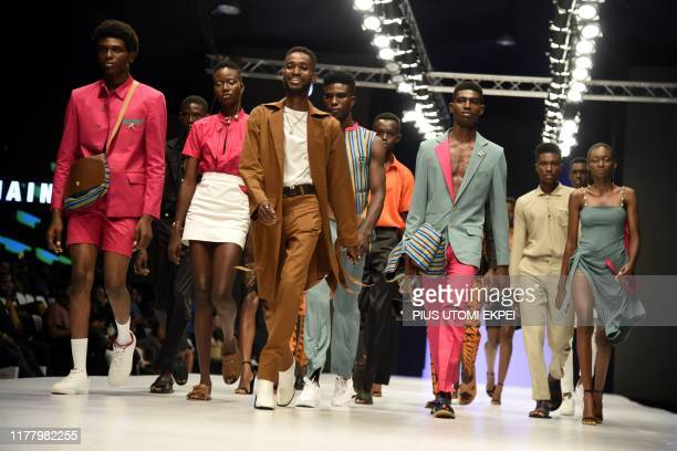 Models wear Jermaine Bleu creations during the yearly Lagos Fashion Week in Lagos, on October 24, 2019. - Lagos Fashion Week is a fashion platform...