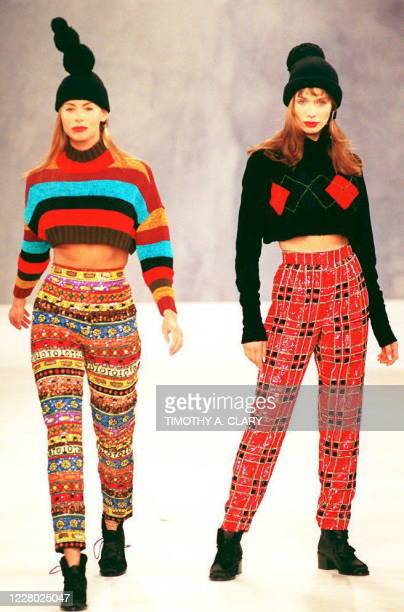 Models wear multicolored pants with mid high sweaters and stocking caps during the Todd Oldham Fall 94 collection showing 07 April 1994