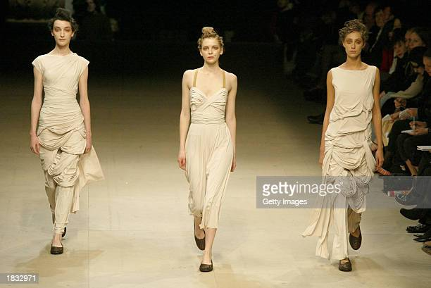 Models wear outfits created by Naoki Takizawa for fashion house Issey Miyake during their Fall/Winter 2004 ready-to-wear collection March 6, 2003 in...