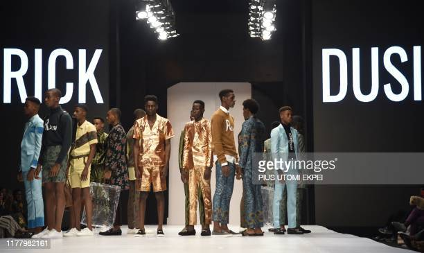 Models wear Rick Dusi creations during the yearly Lagos Fashion Week in Lagos, on October 24, 2019. - Lagos Fashion Week is a fashion platform...