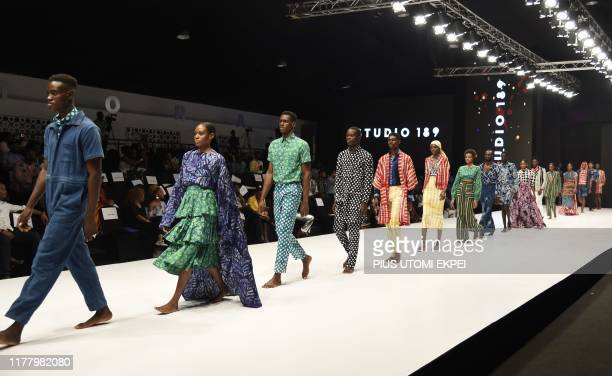 Models wear Studio 189 creations during the yearly Lagos Fashion Week in Lagos, on October 24, 2019. - Lagos Fashion Week is a fashion platform...