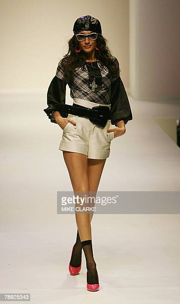 """Models wear the latest fashion entitled """"Romantique Desinvolte"""" by Isaac Yuen at the Hong Kong Fashion Week in Hong Kong, 14 January 2008. More than..."""