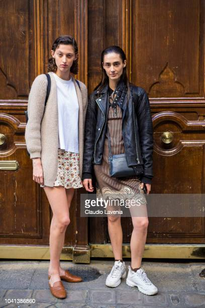 Models wearing a brown dress black leather jacket white sneakers and black crossbody bag and white tshirt beige cardigan printed mini skirt and tan...