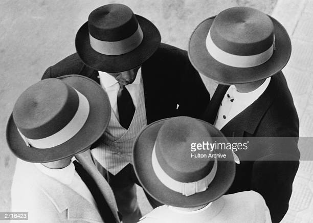 Models wearing a collection of Italian designed hats for winter 1956/7 and spring 1957 at the fifth Men's Fashion Festival San Remo Italy