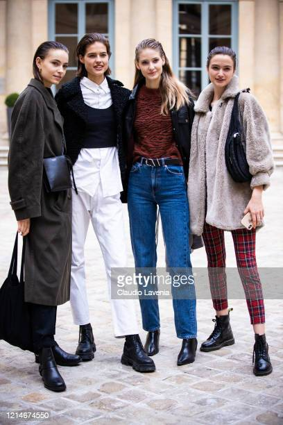 Models, wearing a grey coat and black bag , whit shirt, black top, black decorated jacket and white pants , brown sweater, black leather jacket and...
