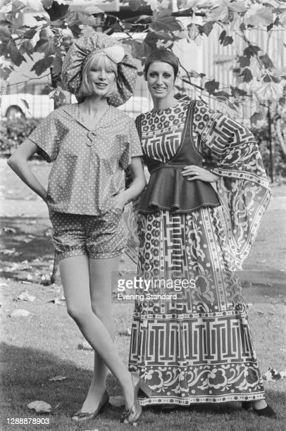 Models wearing a spotted shorts suit with shower cap-style hat, and a maxi dress, UK, November 1971.