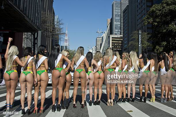 Models wearing bikinis perform at Paulista Avenue in Sao Paulo Brazil on August 3 to promote the Miss Bumbum Brazil 2015 pageant All eyes are on...