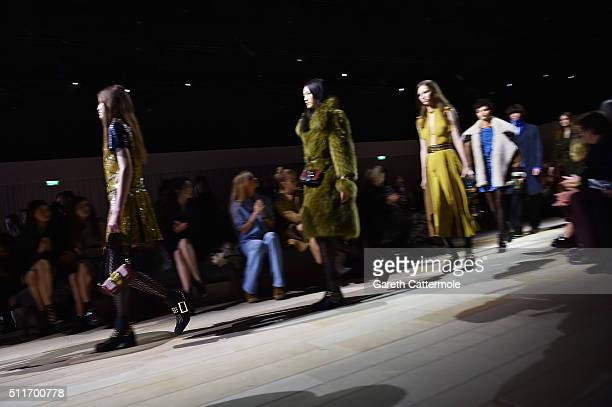 Models wearing Burberry walk the runway during Finale at the Burberry Womenswear February 2016 Show at Kensington Gardens on February 22 2016 in...