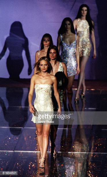Models wearing clothes from Donatella Versace's 1999 collection walk down the runway during the 9th Annual Fire and Ice Ball 09 December at Universal...