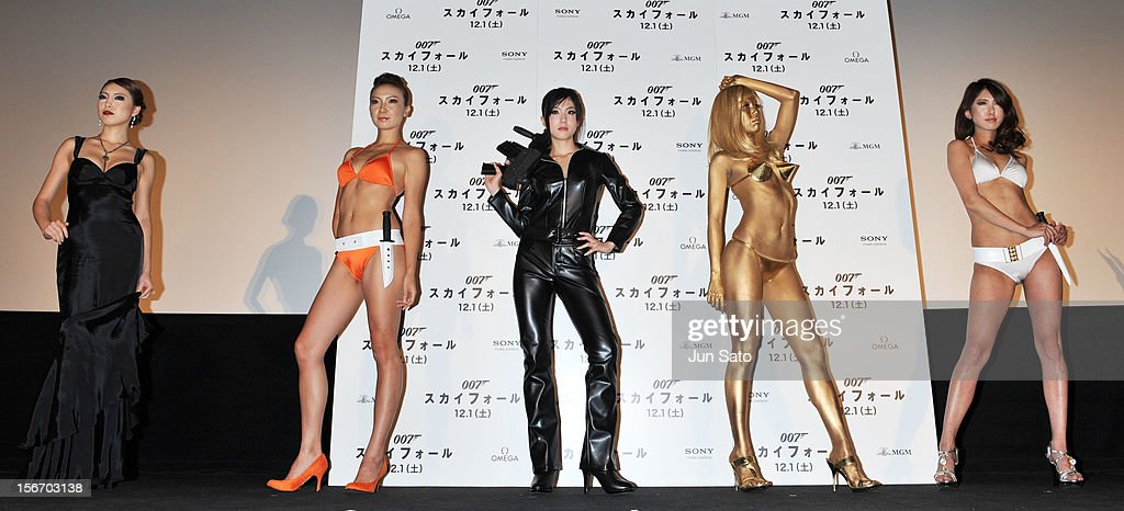 Models wearing costumes from James Bond films pose on stage at the 'Skyfall' Japan Premiere at Toho Cinemas Nichigeki on November 19, 2012 in Tokyo, Japan. The film will open on December 1 in Japan.
