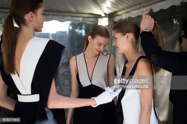 Models wearing creations by Swedish fashion designer Amanda Svart wait backstage prior to modeling before a jury during the 31st edition of the...