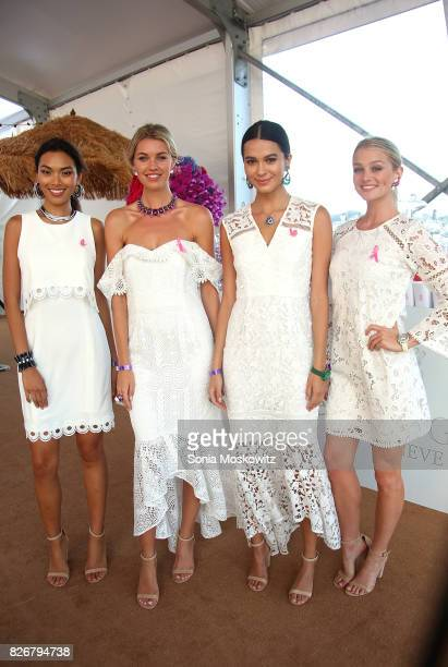 Models wearing De Grisogono jewelry at the Hamptons Paddle and Party for Pink to benefit the Breast Cancer Research Foundationon August 5 2017 at...