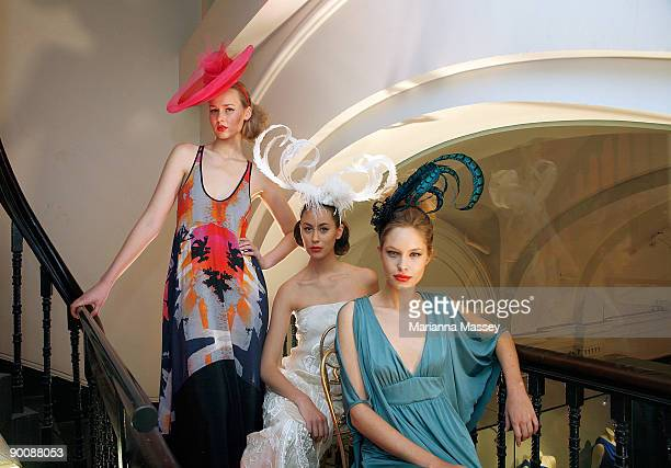Models wearing dresses by designers Manning Cartell Akira and Leona Edmiston and headpieces by Paris Kyne Master Milliner pose at the launch of...