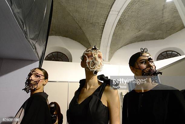 Models wearing face masks are waiting their turn to walk out to runway for RYBALKO show at the Ukrainian Fashion Week in Kiev Ukrainian Fashion Week...