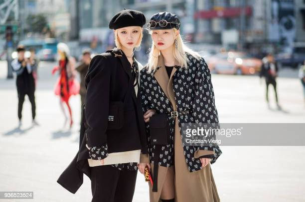Models wearing flat cap belted trench and belted jacket with print is seen at the Hera Seoul Fashion Week 2018 F/W at Dongdaemun Design Plaza on...