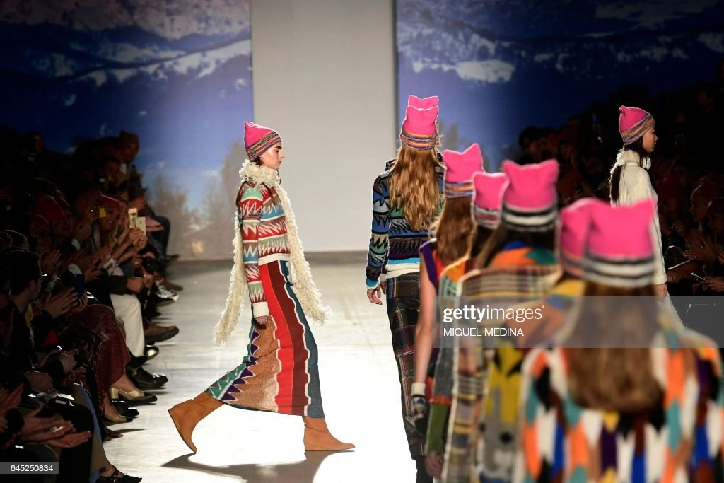 TOPSHOT - Models wearing pink hats walk the runway at the end of the show for fashion house Missoni during the Women's Fall/Winter 2017/2018 fashion week in Milan, on February 25, 2017. Italian designer Angela Missoni brought the political fight to Milan fashion week by ending her autumn-winter 2017 show with models clad in Pussyhats, the pink protest symbols of women's rights. / AFP PHOTO / Miguel MEDINA