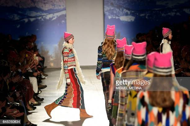 Models wearing pink hats walk the runway at the end of the show for fashion house Missoni during the Women's Fall/Winter 2017/2018 fashion week in...