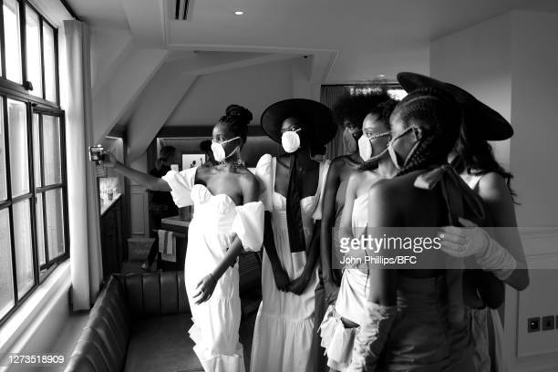 Models wearing PPE face masks take a selfie during the Maison Bent appointments during LFW September 2020 at on September 19, 2020 in London, England.