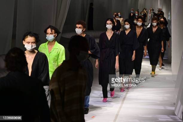 Models wearing protective masks are pictured during the rehearsal prior Fendi's Spring/Summer 2021 women's and mens collection during the Milan...