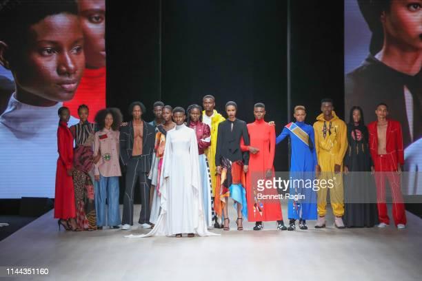 Models wearing Pyer Moss pose on the runway during Arise Fashion Week on April 21, 2019 in Lagos, Nigeria.