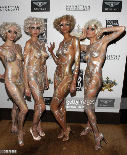 Models wearing Swarovski crystals and body paint attend the Prince Malik Records label launch party at 1OAK on October 18 2010 in New York City