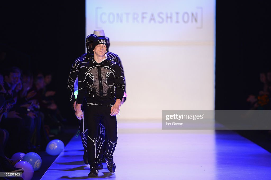Models wearing TaiDo walk the runway at the Contrfashion show during Mercedes-Benz Fashion Week Russia Fall/Winter 2013/2014 at Manege on April 2, 2013 in Moscow, Russia.