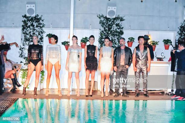 Models wearing the Mister Triple X Collection pose for a photo at the Art Hearts Fashion Holiday Couture du Couture Charity Event Benefiting Toys for...