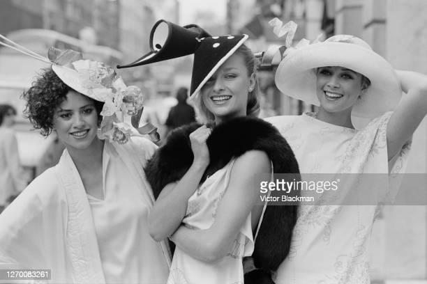 Models wearing unusual hats by milliner David Shilling UK 11th June 1985