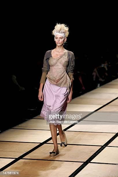 Models wearing Vivienne Westwood during Paris Fashion Week Ready to Wear Spring/Summer 2005 Vivienne Westwood Runway at Carrousel du Louvre in Paris...