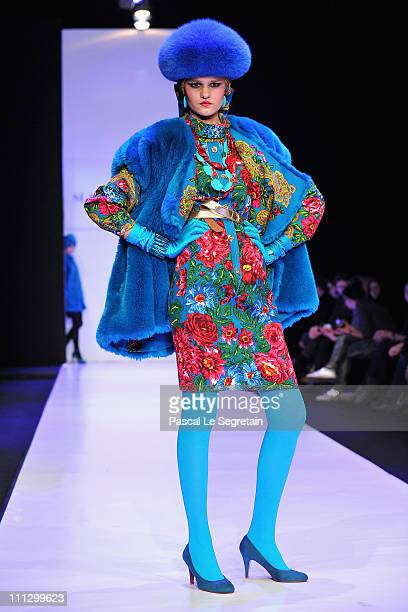 A models wears a creation by designer Slava Zaitsev during his fashion show on Day 1 of the MercedesBenz Fashion Week Russia Fall/Winter 2011/2012 at...