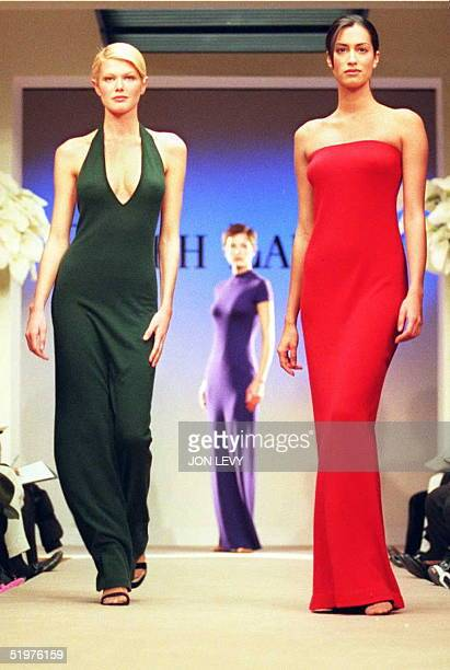 Models wears green purple and red long evening dresses during the showing of the Ralph Lauren Fall 1996 fashion collection 03 April in New York New...