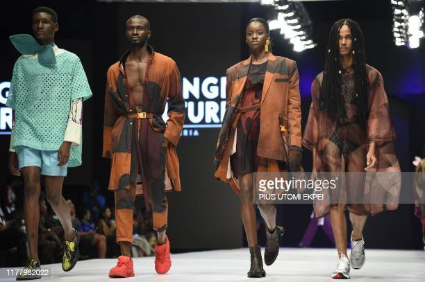 Models wears Orange Culture creations during the yearly Lagos Fashion Week in Lagos, on October 24, 2019. - Lagos Fashion Week is a fashion platform...