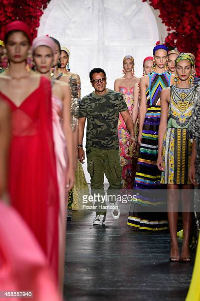Models with designer Naeem Khan walk the runway wearing Naeem Khan Spring 2016 during New York Fashion Week The Shows at The Arc Skylight at Moynihan...